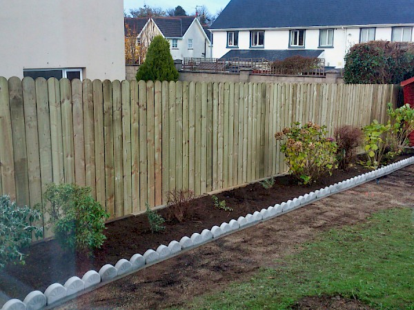 Lollipop fence with flower bed - After